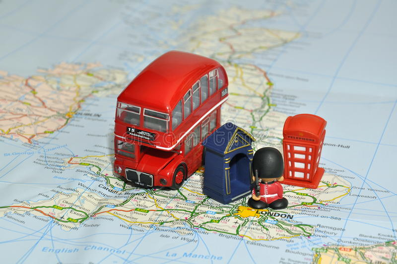 London On Map Of England With Miniature Souvenirs Stock Photography