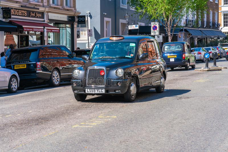 London black cab parked on a street in Knightsbridge, London royalty free stock photography
