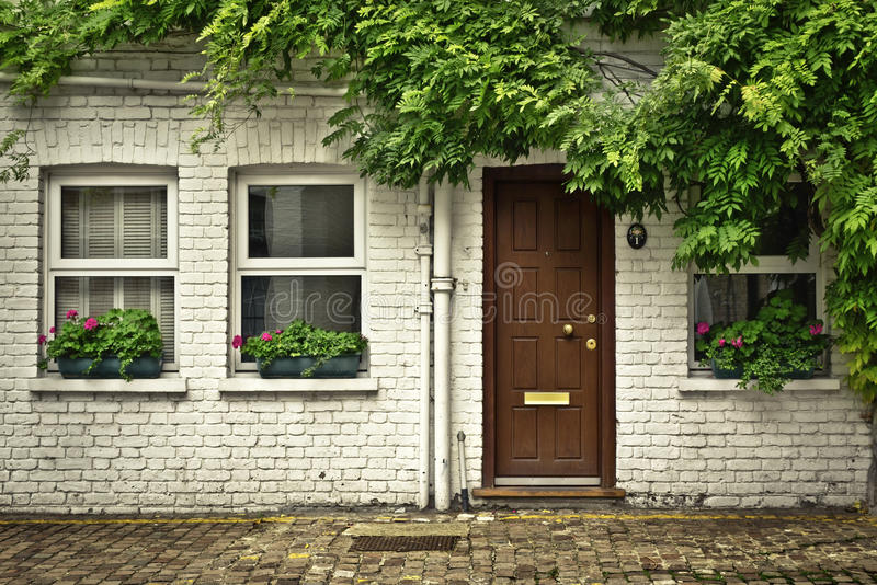 London Mews. Beautiful house front in one of london's cozy mews stock images