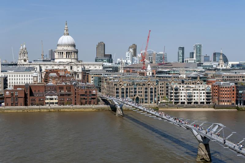 The London Millennium Bridge, a suspension footbridge crossing the River Thames in London and St Paul Cathedral seen in background stock image