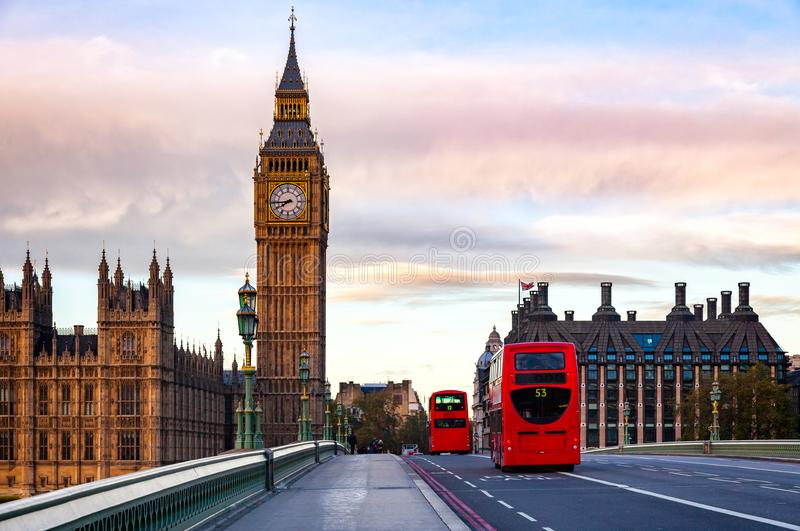 London cityscape with Double Decker buses move along the Westminster Bridge to Elizabeth Tower or Big Ben Palace of Westminster. London morning traffic scene royalty free stock photo