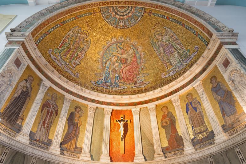 London - The mosaic of Coronation of Virgin Mary and main apse of church Our Lady of the Assumption. LONDON, GREAT BRITAIN - SEPTEMBER 18, 2017: The mosaic of stock image