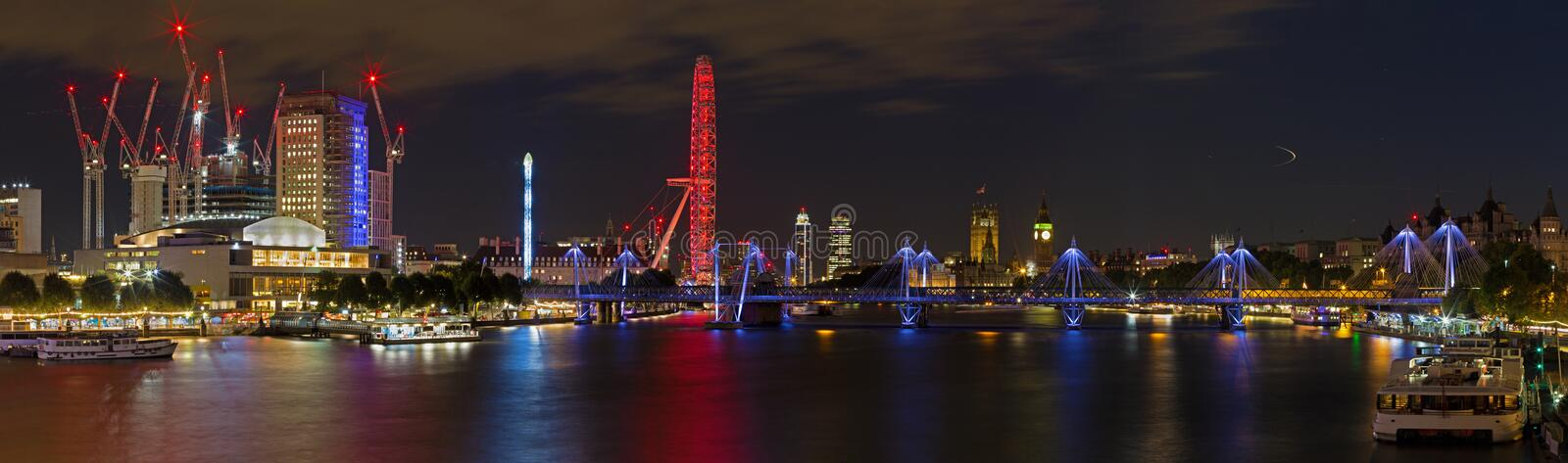 London - The nightly panorama of the City with the Big Ben and the London Eye. royalty free stock photography