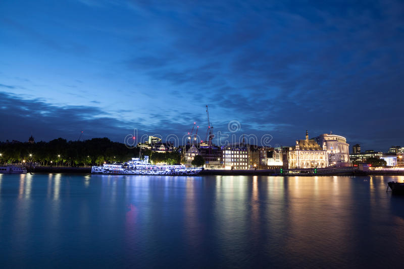 London nights from the piers. On the blue hour stock images