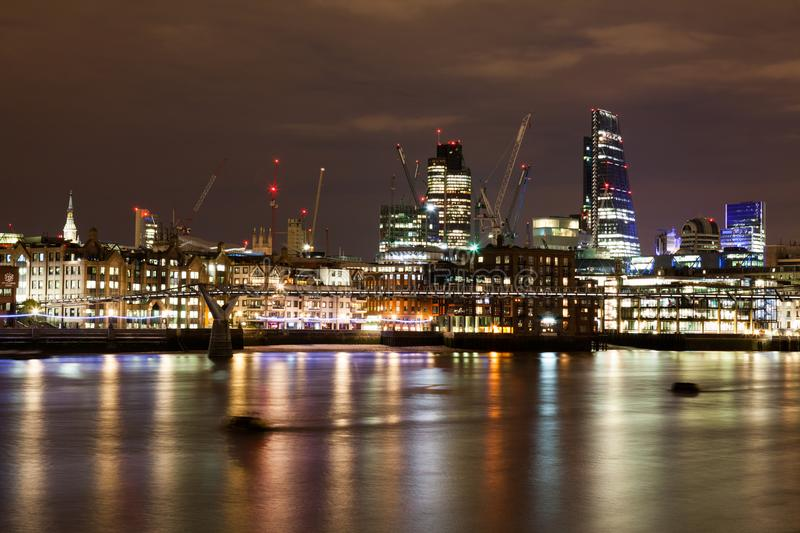 London nights from the piers. With Canary Wharf view stock photography