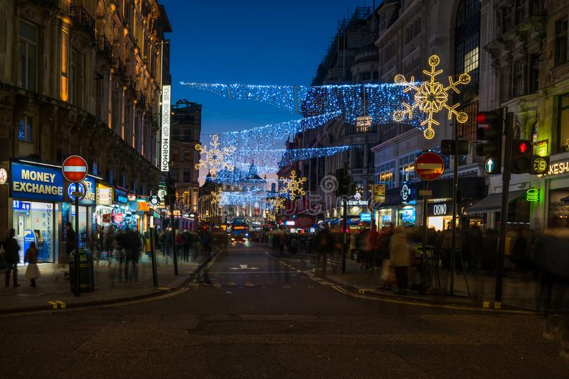 Christmas decorations on Coventry Street in Central London, UK stock image