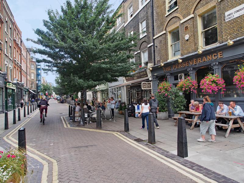 London,  old street with quaint shops and pubs. The Bloomsbury district near the University of London has old streets with quaint shops and pubs stock photography