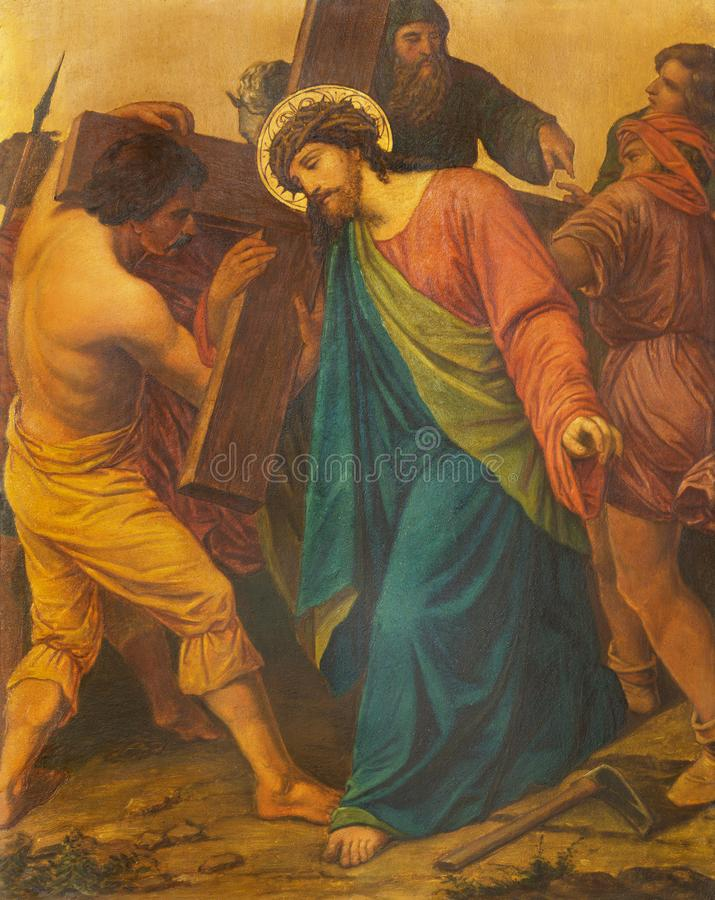 London - The painting Jesus is helped by Simon of Cyrene to carry his cross in church of St. James Spanish Place. LONDON, GREAT BRITAIN - SEPTEMBER 17, 2017: The royalty free stock photo