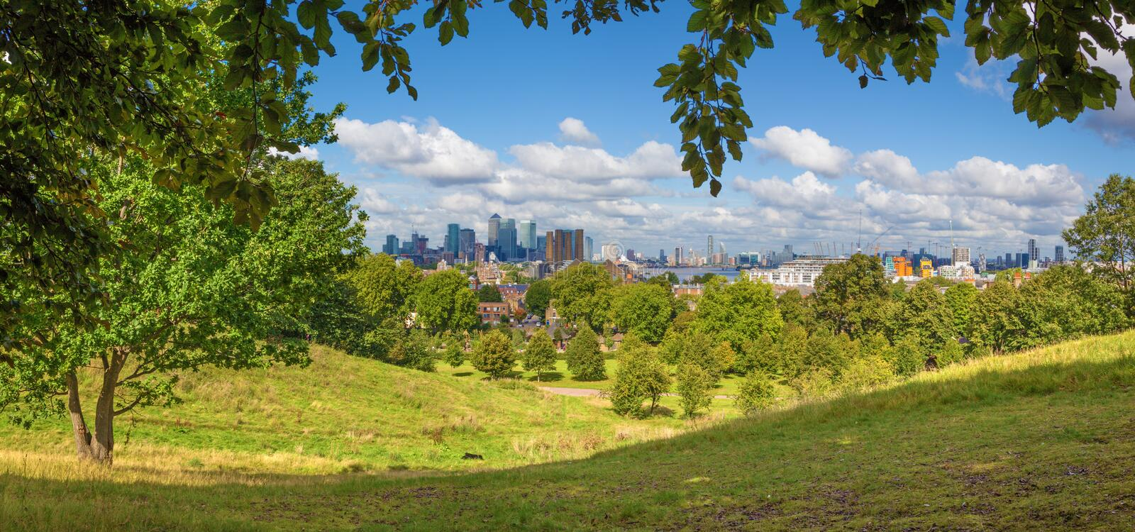 London - The panorama of the Canary Wharf and the City from Greenwich park royalty free stock images