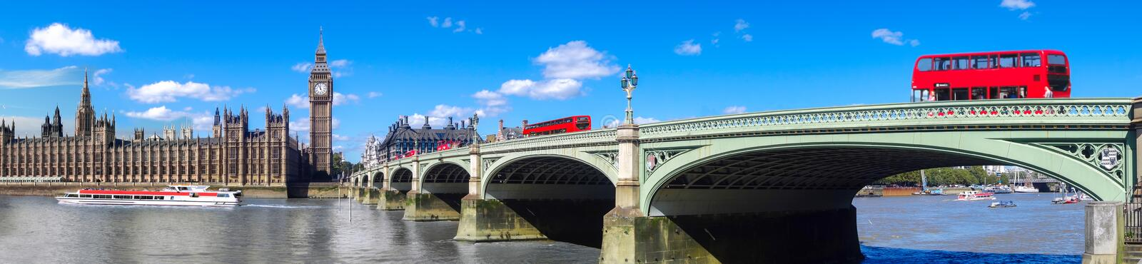 London panorama with red buses on bridge against Big Ben in England, UK stock photography