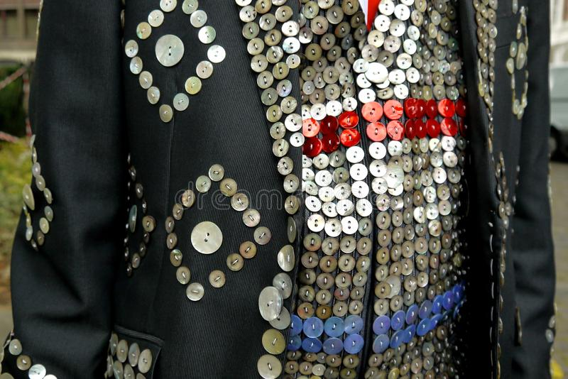 London: pearly king suit detail. Traditional East London pearly king charity fund-raiser suit detail with buttons royalty free stock photography