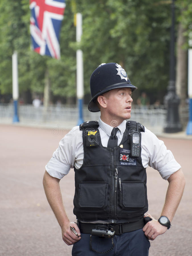 London policeman. A London policeman patrolling at the Mall avenue in London, UK stock photo