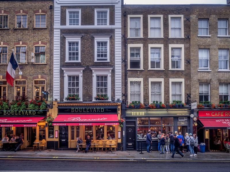 London pubs and restaurants. LONDON UK - AUG 2: London pubs and restaurants in the Covent Garden area on August 2, 2017 in London England. London has many royalty free stock images
