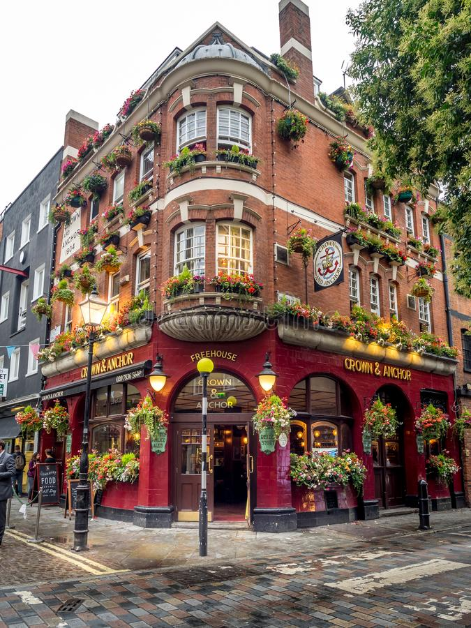 London pubs and restaurants. LONDON UK - AUG 2: London pubs and restaurants in the Covent Garden area on August 2, 2017 in London England. London has many royalty free stock photo