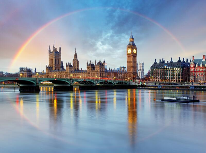 London with rainbow - Houses of parliament - Big ben royalty free stock image