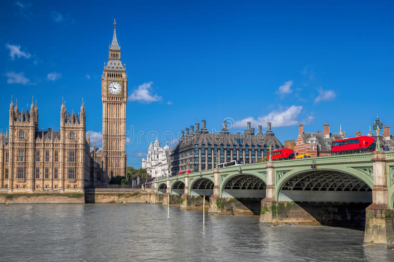 London with red buses against Big Ben in England, UK stock photo