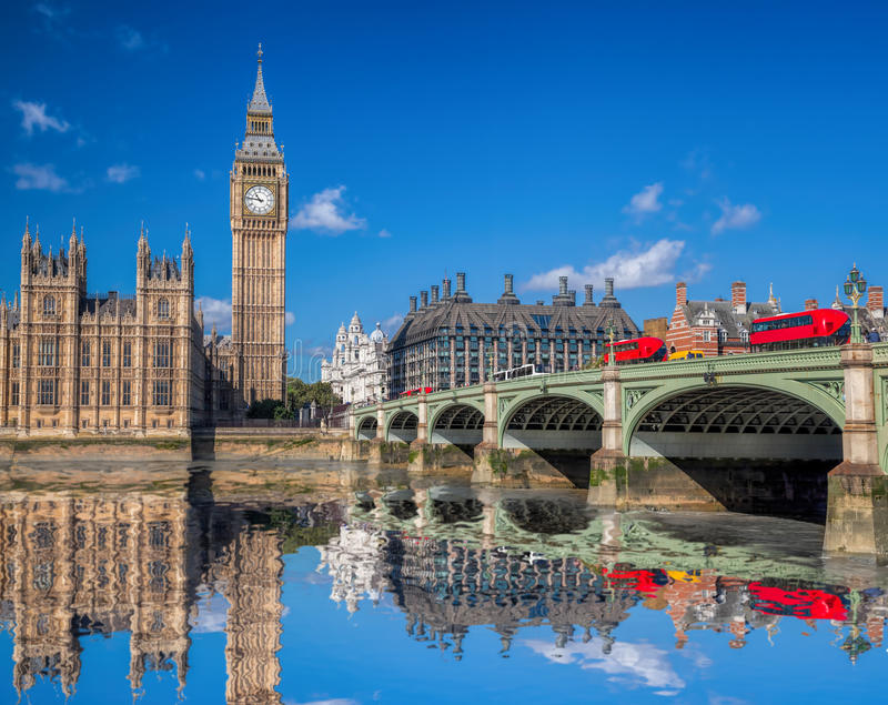 London with red buses against Big Ben in England, UK stock photography