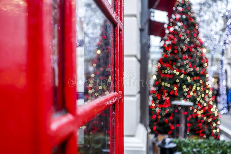 London red phone box and Christmas tree royalty free stock image