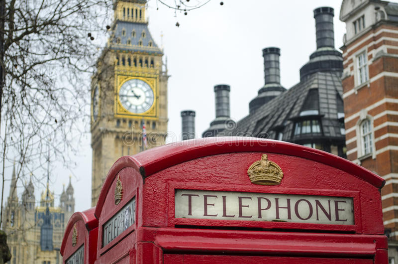 London Red telephone box with Big Ben in background. Picture taken in Westminster, London, England. A classic red telephone box with houses of Parliament in the stock photography
