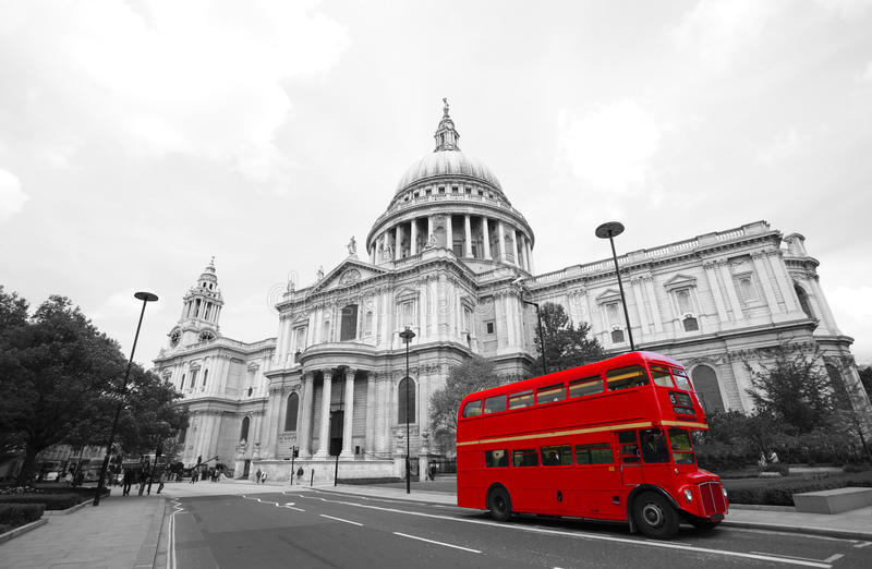 London Routemaster Bus, St Paul's Cathedral. London's iconic Routemaster Bus and St Paul's Cathedral is in the background royalty free stock photos