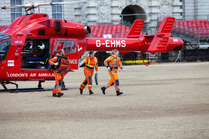 London's Air Ambulance Helicopter team. LONDON - JUNE 11: London's Air Ambulance McDonnell Douglas MD 902 Explorer Helicopter landed in Horse Guards Parade stock photography