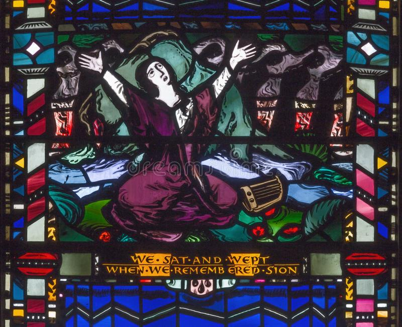 London - The scene of The sorrow in the captivity of the Jews in Babylon on the stained glass in church St Etheldreda. LONDON, GREAT BRITAIN - SEPTEMBER 16, 2017 stock photography