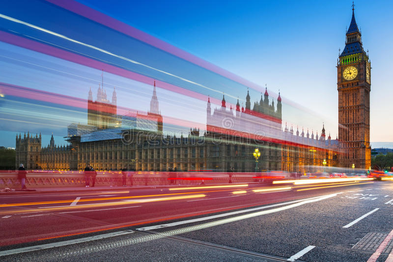 London scenery at Westminter bridge with Big Ben and blurred red. London scenery at Westminster bridge with Big Ben and blurred red bus, UK stock photo