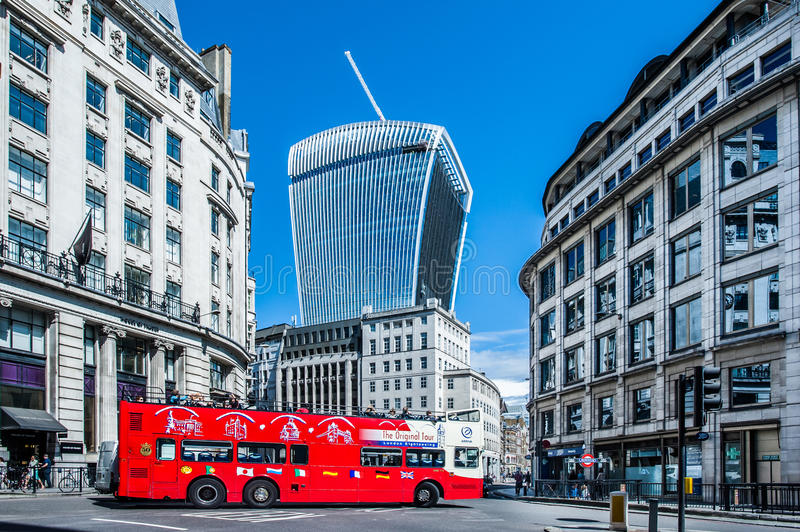 A London sightseeing double-decker bus on King William St in the City of London. London, UK - August 11, 2014: A London sightseeing double-decker bus on King royalty free stock photos