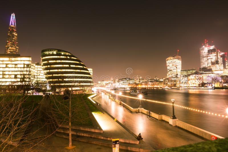 London Skyline at Night over the Chard and Thames River.  stock photo