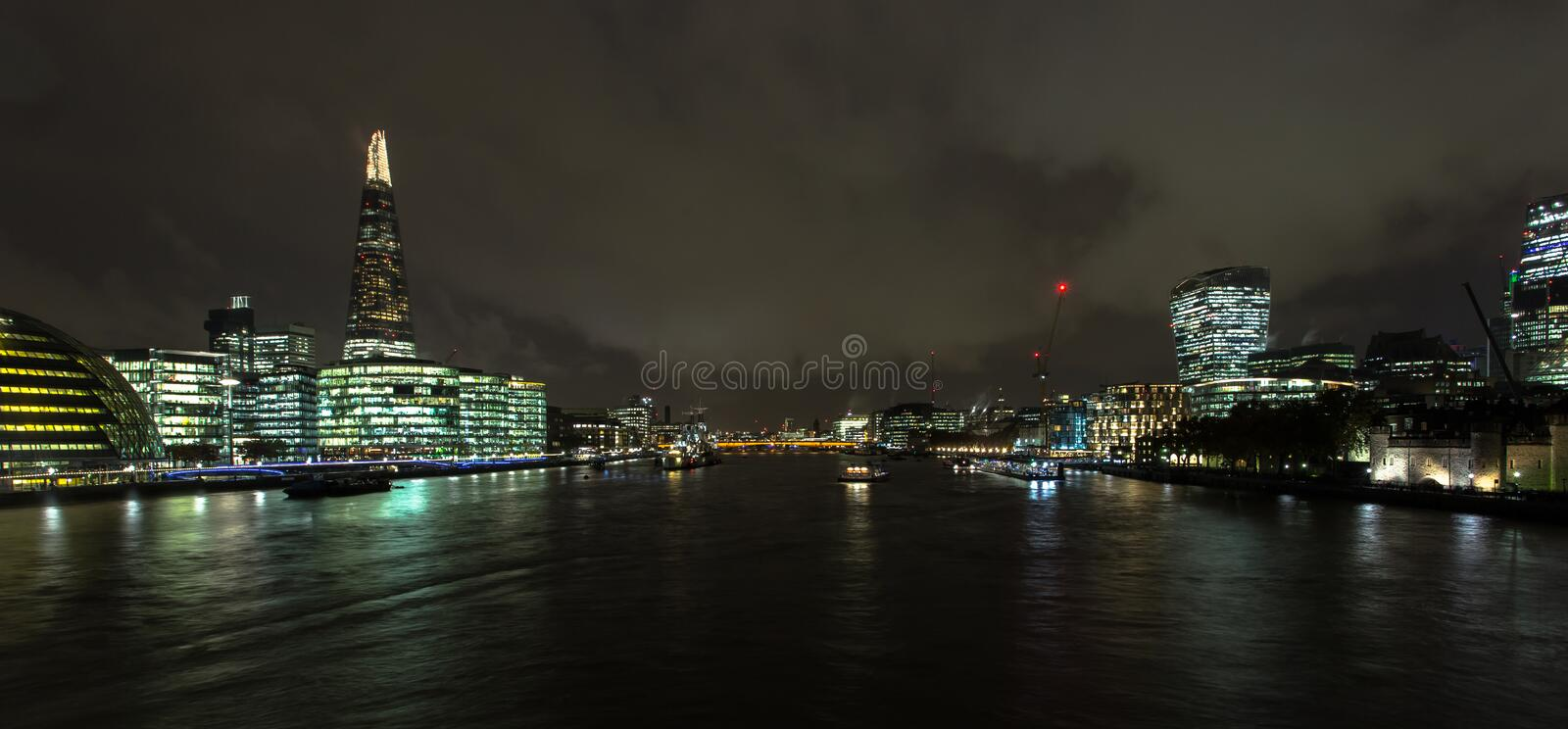 London skyline over the River Thames at night stock photography