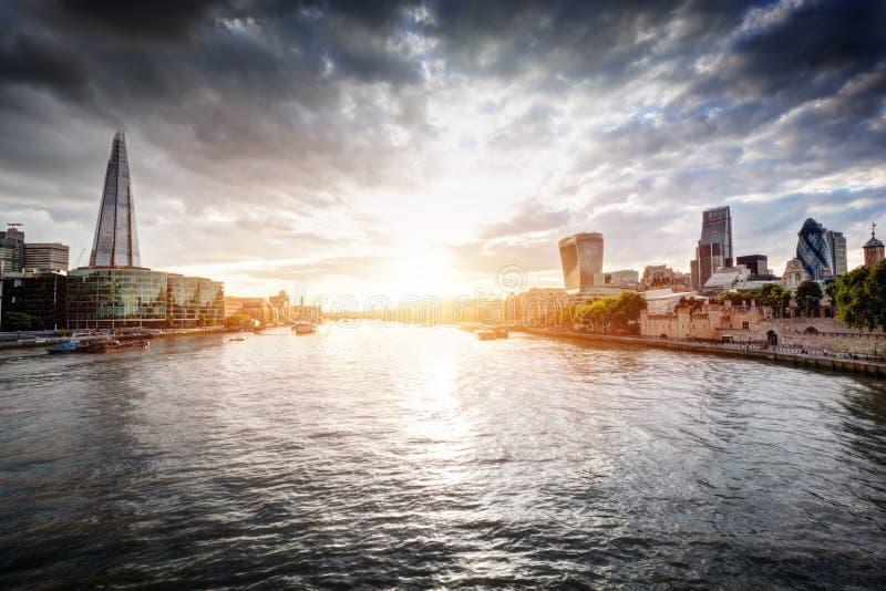 London skyline at sunset, England the UK. River Thames, the Shard, City Hall. stock photos