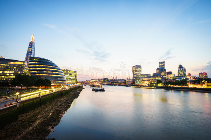 London skyline at sunset, England the UK. River Thames, the Shard, City Hall. royalty free stock photo