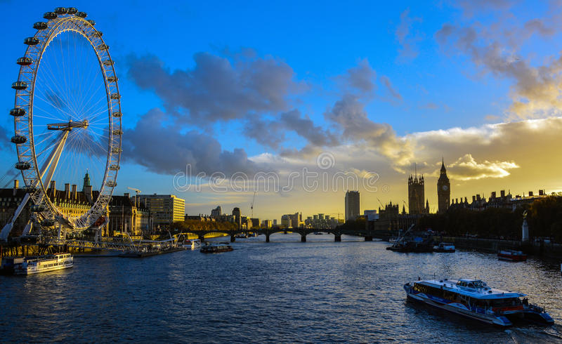 London Skyline at sunset. A picture taken from the Millennium Bridge at sunset looking across the Thames at the London Eye, Westminster stock photo