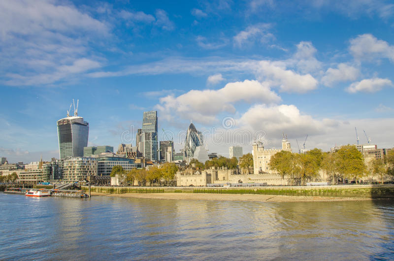 London skyline, United Kingdom. Cityscape with modern buildings and Tower of London in autumn under blue bright sky stock images
