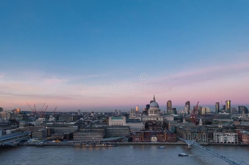 London skyline over Thames St Paul cathedral skyscrapers in twilight. London skyline with view over River Thames, St Pauls Cathedral and Barbican buildings in royalty free stock photo