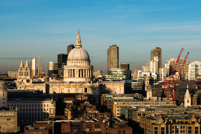 London skyline with view over St Pauls Cathedral and Barbican. Buildings in background with construction work cranes stock images
