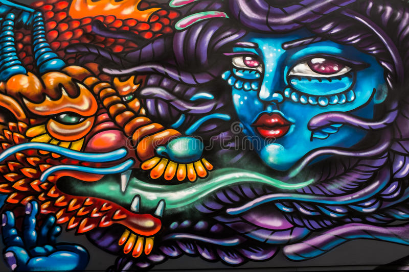 London street graffiti of woman's face and Dragon stock photography