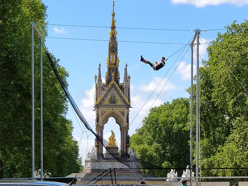 Flying trapeze school. London 2018 Summer Courses: Gorilla Circus teaches flying trapeze in Regent Park and Kensington Gardens near Albert Memorial royalty free stock photography