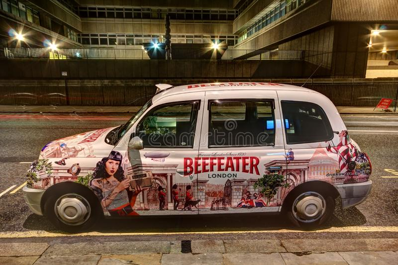 Download London Taxi Cab With Advertising Paintwork Editorial Photo - Image: 23000556