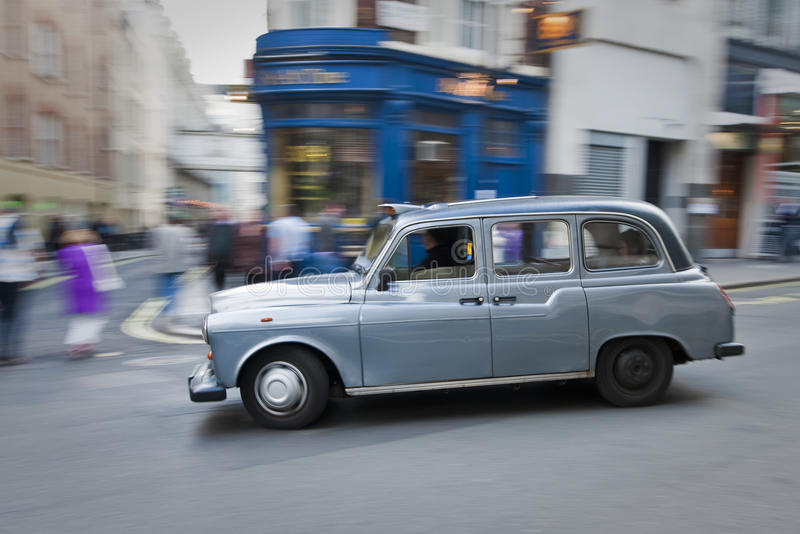 Download London Taxi in motion stock image. Image of sidewalk - 15489993