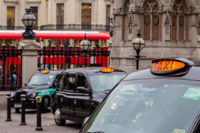 London Taxi's and a Bus royalty free stock photography