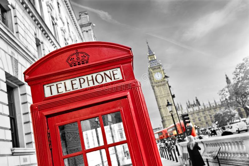London telephone booth and big ben. London telephone booth in front of  big ben and the houses of parliament in England royalty free stock image