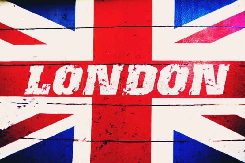 London-Text auf alter entworfener Schmutzbriten-Flagge lizenzfreie abbildung