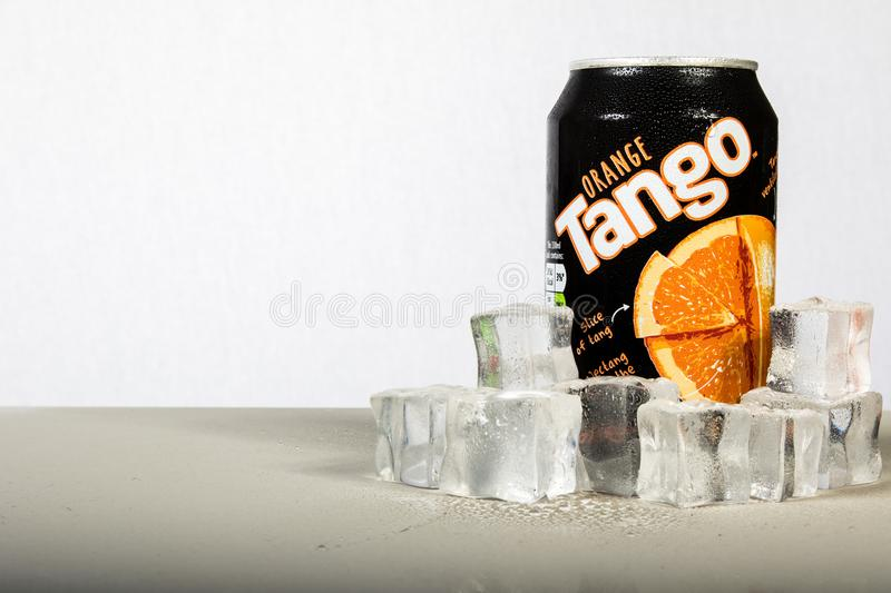 A can of chilled Orange Tango with ice against a white background stock image