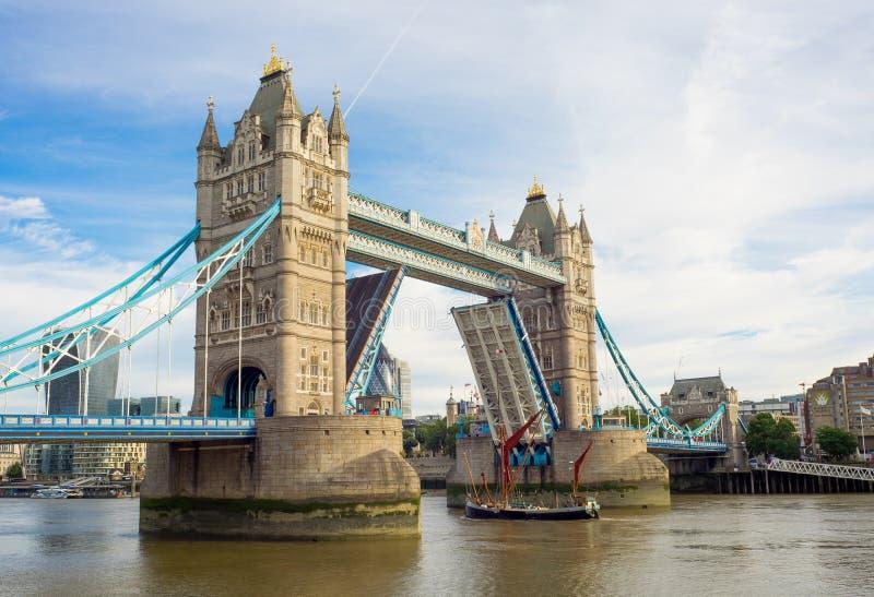 London Tower bridge lifting. Tower bridge lifting to allow boat through royalty free stock image