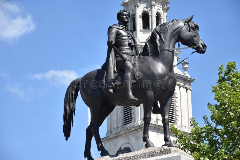 London Trafalgar Square George droppstaty i UK England royaltyfria bilder