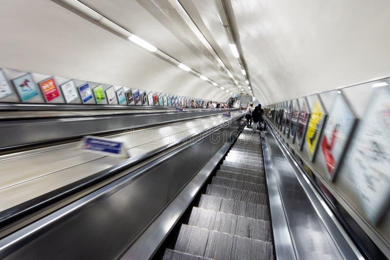 London tube escalators motion view. LONDON, UK - JUL 2, 2015: London underground tube escalators motion view station city train traffic british europe inside royalty free stock images