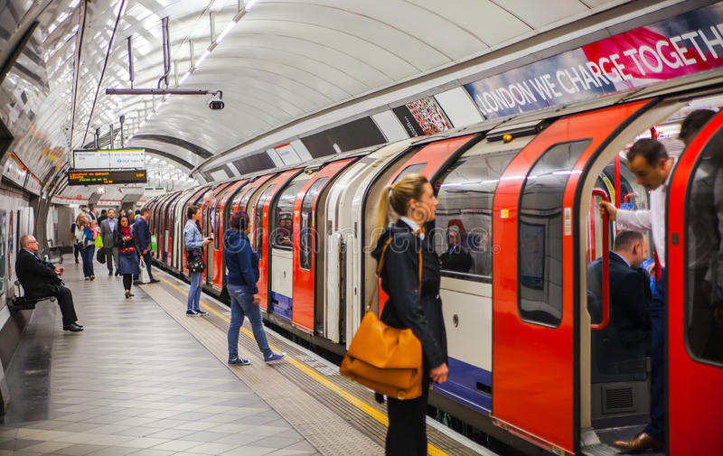 LONDON, tube station with people waiting for the train stock images