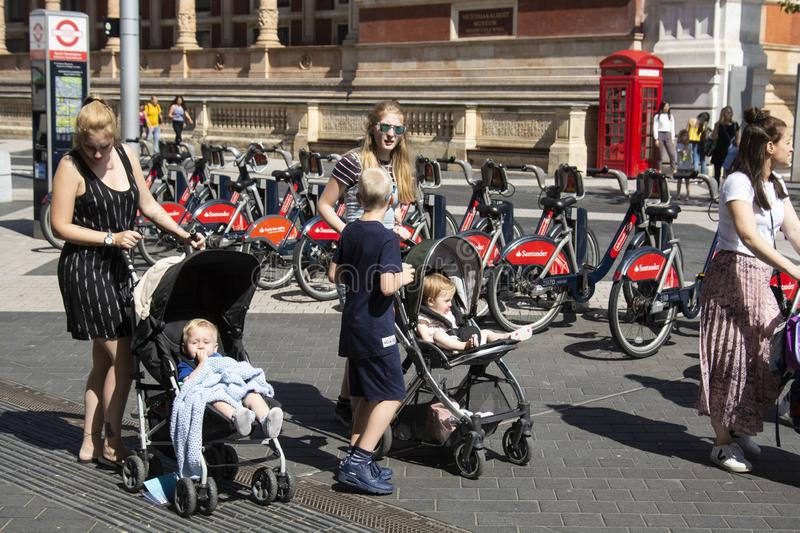 London, U.K. August 22, 2019 - mothers with babys walking down the street. A group of people, tourists visiting London royalty free stock photography
