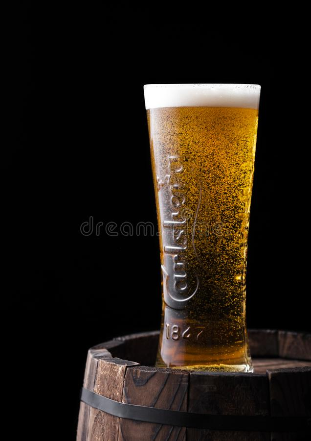 Free LONDON, UK - APRIL 27, 2018: Original Glass Of Carlsberg Beer On Top Of Old Wooden Barrel With Dew And Bubbles Royalty Free Stock Photos - 156182838